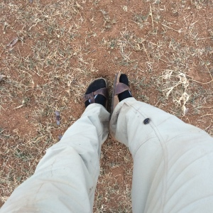 My outfit post-rainstorm: black athletic socks, Birkenstock standals, and dirty dry-fit pants. Fashionable and functional, I always say.